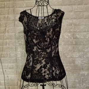 Gorgeous black lace top with nude satin lining